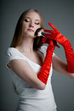Girl in gloves with brush Royalty Free Stock Photo