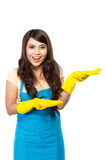 Girl with gloves showing blank area Royalty Free Stock Image