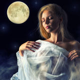 Girl in the glow of the moon Royalty Free Stock Image
