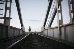 The girl on railway Royalty Free Stock Photo