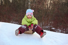 Girl go downward from hill Royalty Free Stock Photo