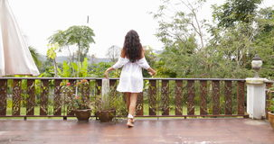 Girl Go Out To Terrace Stretching Arms Back Rear View, Enjoy Morning View Of Tropic Forest. Slow Motion 60 stock footage