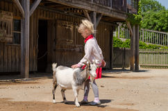 Girl and goat Stock Photo