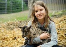 Girl with goatling Stock Images