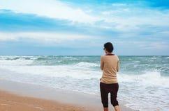 The girl goes along the seashore Royalty Free Stock Photo