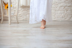 Girl goes barefoot on the floor Stock Photography