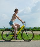 Girl goes on bicycle Stock Photography