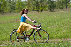 Girl goes by bicycle Royalty Free Stock Images