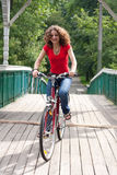 Girl goes by bicycle Royalty Free Stock Image