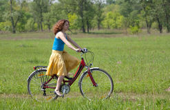 Girl goes by bicycle Stock Image