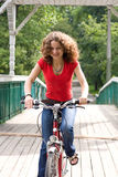 Girl goes by  bicycle Stock Images