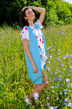 Girl goes on the field with cornflowers Royalty Free Stock Photos