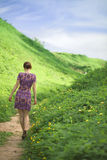 Girl goes on a footpath Stock Photography