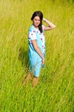 The girl goes on the green field Royalty Free Stock Photo