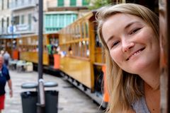 The girl goes by historic tram. Historic tram in Soller, Spain Stock Photography
