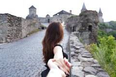 Girl goes holding the hand Stock Photography