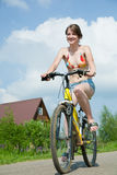 Girl Goes On Bicycle Royalty Free Stock Photography