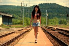 Girl goes on rails at sunset Stock Photography