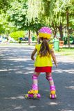Girl goes rollerblading in the park Royalty Free Stock Photos
