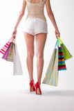 Girl goes with the shopping bags. Royalty Free Stock Image