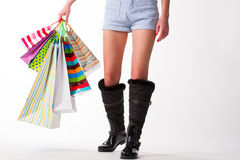 Girl goes with shopping bags. Stock Photography