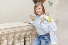Girl goes shopping in the mall Stock Photography
