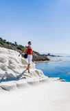 """The girl goes on a slope of white cliff called  """"Scala dei Turchi"""" Royalty Free Stock Photos"""