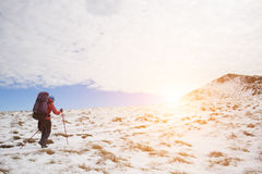 The girl goes through the snow in the mountains. Stock Photography