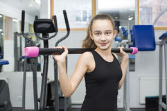 Girl goes in for sports Stock Images