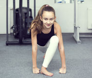 Girl goes in for sports. Girl is engaged in sports and gymnastics in the gym stock photos