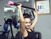 Girl goes in for sports. Girl is engaged in sports and gymnastics in the gym royalty free stock photos