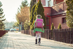 Girl goes to school Royalty Free Stock Photo
