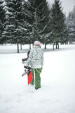 The girl goes to snowboard ride Stock Photography