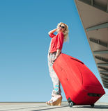 Girl goes on vacation with suitcase Stock Photos
