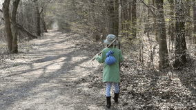 Girl goes through the woods stock footage