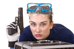 Girl in goggles and gun. Royalty Free Stock Images