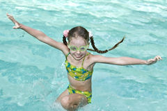 Girl in goggles learn swiml. Royalty Free Stock Image