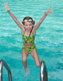Girl in goggles leaves pool. Royalty Free Stock Photos