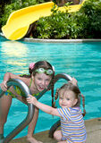 Girl in goggles leaves pool. Stock Photos