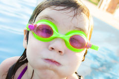 Girl with Goggles. A little girl at a swimming pool wearing goggles Royalty Free Stock Images