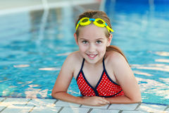 Girl with goggles in swimming pool Royalty Free Stock Photos