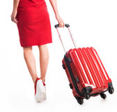 Girl going away with suitcase Royalty Free Stock Photography