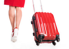Girl going away with suitcase Stock Images