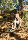 Girl going down in forest Stock Photography