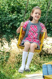 Girl going for drive on merry-go-round Royalty Free Stock Photography