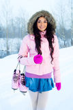 Girl going ice skating Stock Images
