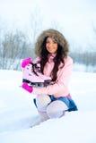 Girl  going ice skating Stock Photography