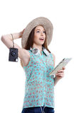 Girl going on a journey, white background. Portrait of happy tourist woman in hat on holiday on white backgraund Royalty Free Stock Images