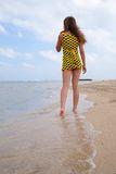 Girl going at resort sand beach Royalty Free Stock Photography
