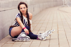 Girl going rollerblading Royalty Free Stock Images